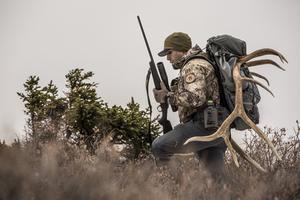 deer hunter wearing camo