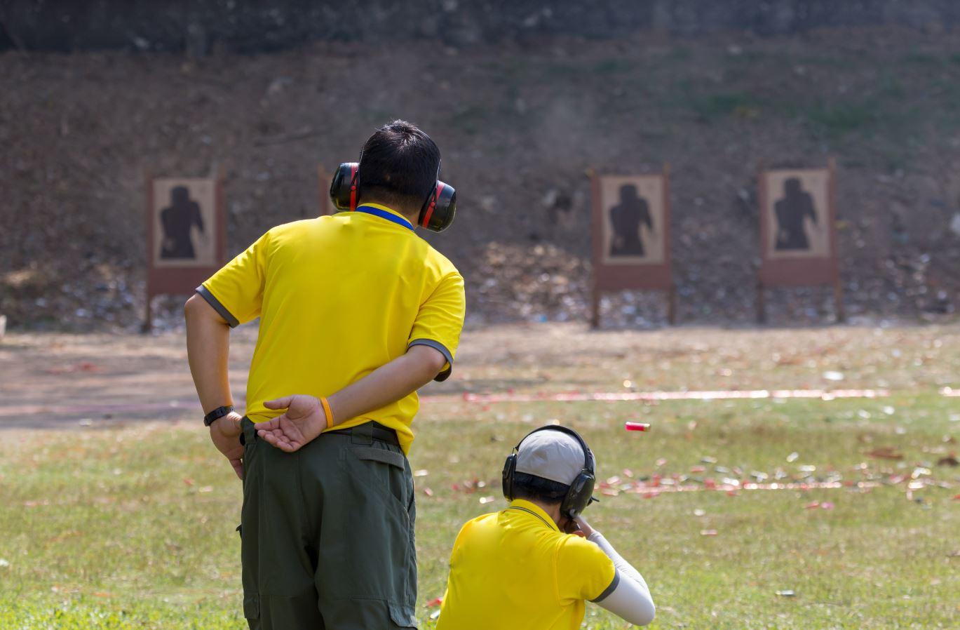 Guy shooting target practice