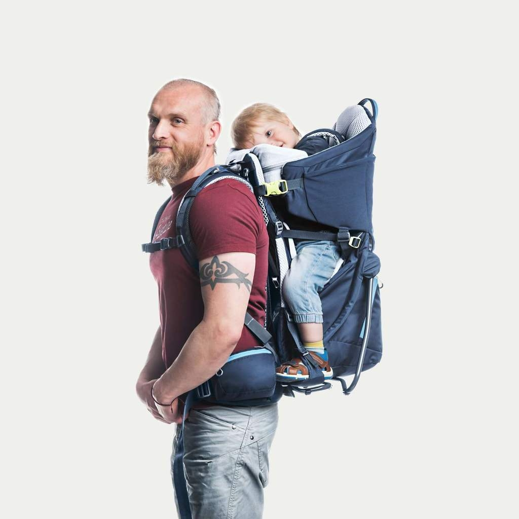 Man with a child in child-carrier backpack.