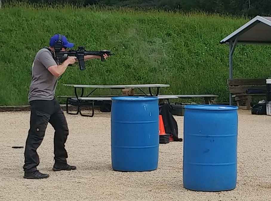 Standing offhand tactical shooting in Fjallraven trousers.