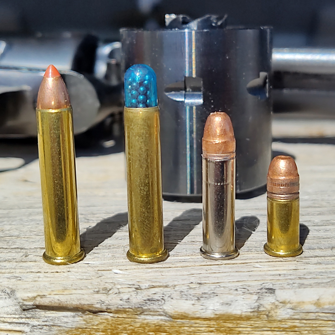 4 rimfire ammunition cartridges lined up from largest to smallest.