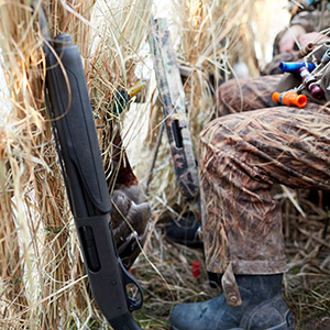 duck hunter wearing camo in hunting blind