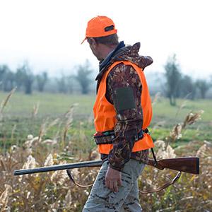 duck hunter wearing blaze orange safety vest